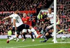 Goalkeeper Hugo Lloris of Spurs dives in vain as Michael Carrick of Manchester United scores his team's second goal during the Barclays Premier League match between Manchester United and Tottenham Hotspur at Old Trafford on March 15, 2015 in Manchester, England.