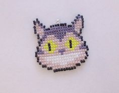 This is the Awesome Cheshire Cat!! It is about 1.5 x 1.5 inches. You can have it as either a necklace or key chain. The necklace is Ball chain and it's about 24 inches long. I attach it with a jump ring. If you prefer another type of necklace let me know and we will see what we can come up with. Colors may vary slightly when made to order. Every beaded item has been handmade by me, individually stitching one Miyuki Delica seed bead at a time with a needle and Wildfire thermally bonded…