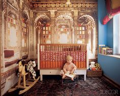 INTERNATIONAL FLAIR  Photographer Pieter Estersohn transformed an image he took in Udaipur into a giant gleaming mural for his son Elio's bedroom in their New York City penthouse; the crib is by Netto Collection.