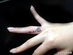 small totem #flower #tattoo on the finger