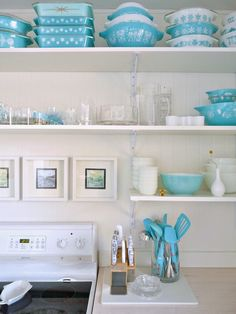 Honest Thoughts on Open Shelving (we love the pop of color from the aqua dishes, utensils, and kitchen accents!) via @danslelakehouse