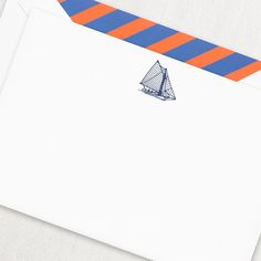 Engraved Sailboat Correspondence Card: Summers on the coast are simply divine. An homage to all things sand and sea, our engraved sailboat card is the perfect reminder that the life aquatic is quite lovely. Paired with our Orange and Blue Stripe envelope liner for additional pep.