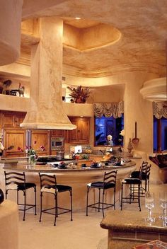 #kitchen I love the hood that comes down over the island. It adds such drama to the room and highlights the materials at the same time.