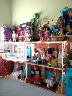 """The East wall and my doll space. It's made of 1×2's and 2'×4' 3/4"""" mdf board. I wanted something easy to build and easy to take down to move."""