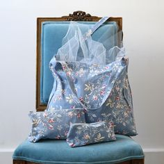 New in - This floral detailed travel collection has a blue background. #rachelashwell #shopshabby