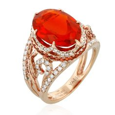 Look at this fiery-colored ring from the Lyra Collection by Yael Designs, featuring 3.82 ct. fire opal center accented with 0.39 cts. t.w. orange sapphires and 0.58 cts. t.w. white diamonds, all this in a gorgeous 18k rose gold setting of twisting patterns and scalloped lines. What a bright and stunning piece of jewelry! www.diamonds.pro