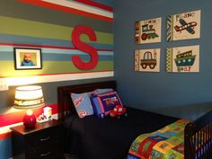 Big boy bedroom.....Blue Daisy, Benjamin Moore on the walls and accent striped wall.