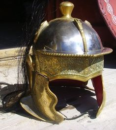 A beautiful 3rd century cavalry helmet was found at Heddernheim in Germany. The helmet is of iron, with beautifully embossed and engraved bronze skinning. The peak on the original was lost.