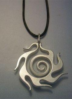 talismanes amuletos y símbolos | colgante sol celta Beltane