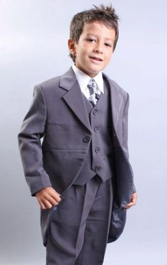 Boys' morning dress.  Maybe with a  dusky blue waistcoat and some kind of gold accent to match the colour scheme