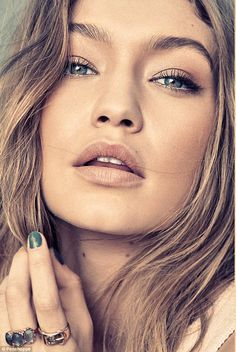 She nailed it: Gigi also gives a flash of her perfect green manicure as she poses in the shots