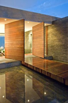 A modern entrance which has throwback features of a traditional mote. Designed by Alejandro Restrepo Montoya + Camilo Andrés Mejía Bravo + Andrés Felipe Mesa Trujillo Residential Architecture, Amazing Architecture, Contemporary Architecture, Architecture Details, Interior Architecture, Amazing Buildings, Installation Architecture, Lobby Interior, Minimalist Architecture