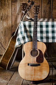 Acoustic guitars awaiting use in a rustic cabin. Copyright Heather Applegate