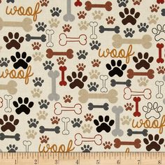 Timeless Treasures Dog Bones & Paw Prints Cream from @fabricdotcom  Designed for Timeless Treasures, this cotton print fabric is perfect for quilting, apparel and home decor accents. Colors include cinnamon, brown, grey, black, gold and cream.