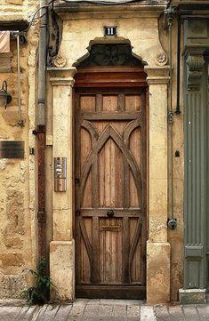 Artistic wood door in Sommieres, France.