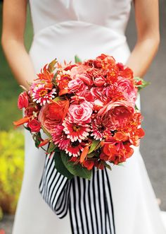 This vibrant bouquet included 'Romantic Antike' roses, begonias, zinnias, carnations and gartenmeister fuchsias bound with a wide striped ribbon. Love the ribbon! Red Bouquet Wedding, Summer Wedding Bouquets, Bride Bouquets, Red Wedding, Floral Wedding, Wedding Colors, Wedding Flowers, Stripe Wedding, Ribbon Wedding