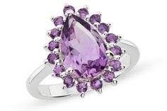 Make a dramatic statement with the deep, rich tones on display in this delicate ring. Purple amethysts are prong set in a classic pear-shaped design rendered in gleaming sterling silver. The perfect accessory for any occasion.