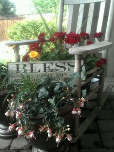 Old wooden rocking chair makes a great planter for the front porch.