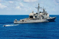 Sailors assigned to the guided-missile cruiser USS Mobile Bay (CG 53) conduct small boat operations.
