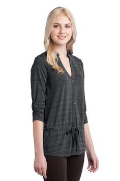 OGIO® Elixir Tunic. This tunic features bias-cut details and a playful drawcord waist. 4.3-ounce, 96/4 poly/spandex jersey with stay-cool wicking technology. OGIO heat transfer label for tag free comfort. Self-fabric, bias-cut collar. 6-button, bias-cut placket with O debossed metal buttons. 3/4 sleeves with ruching. Pleat at back yoke. Self-fabric, bias-cut drawcord tunnel with dyed-to-match drawcord with metal tips. Woven OGIO badge at hem Ladies Sizes: XS-4XL $53.98 range