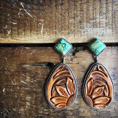 Odessa Earrings - Tooled leather and tuquoise earrings. Teardrop detailed hand tooled leather. Solid sterling silver trim and back. Real turquoise diamond shape post. Handcrafted in America. Cowgirl style. Rodeo fashion. Women's Western Wear. Ranch style. Boho Cowgirl.  https://savannahsevens.com/products/odessa-earrings