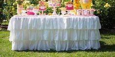 I would love to use this gorgeous tablecloth for a jewelry show.   Ruffled Tablecloth by PaulaAndErika on Etsy, $220.00
