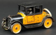 "Arcade 1922 Dodge,Arcade, cast iron, painted in orange and black color scheme, same as Arcade's Yellow Cabs' features seated driver, spare mounted on rear. 8 1/2"" Long"