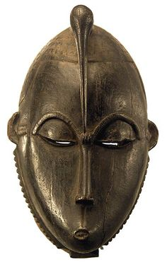 The Baule are one of the Akan peoples. They moved west to the Ivory Coast more than 200 years ago and adpted masking traditions from their neighbors, the Guro, Senufo and Yaure peoples. There are three basic types used in a special dance of rejoicing called Goli, symbolizing the social order. These masks are Kpan, with elaborate coiffures and refined carving; they represent the Senior female in the ceremonies.