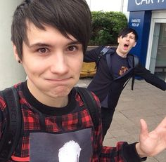 Dan and Phil being their cute selves, all this picture is missing is a llama and lion hat!