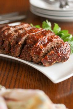 Gluten free slow cooker meatloaf is moist and tender, with a delicious crusty glaze. This is comfort food at its very finest! Click through for recipe!