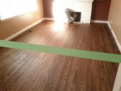 Blog Post on removing glued down carpet/underpad and refinishing hardwood with stain. Stain was 1/2 Walnut 1/2 Natural.