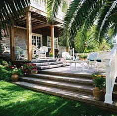 Tiered Decking Designs With Plant Pots And White Wicker Furniture