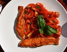Delicious salmon with cherry tomatoes and basil at T-Beach. Grand Hotel Tremezzo in Lake Como, Italy
