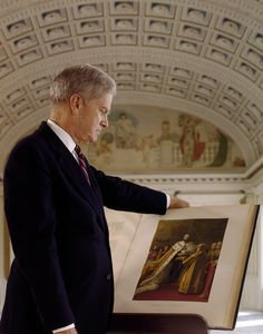 Dr. James H. Billington, the 13th Librarian of Congress, who served from 1987to 2015, looking at one of the rare books in the Library of Congress Thomas Jefferson Building. The former professor of Russian and European history at Harvard and Princeton also served as Director of the Woodrow Wilson International Center for Scholars from 1973 to 1987. Photo by Carol M. Highsmith, probably late 1980s or 1990s. Carol M. Highsmith's America, Library of Congress Prints and Photographs Division.