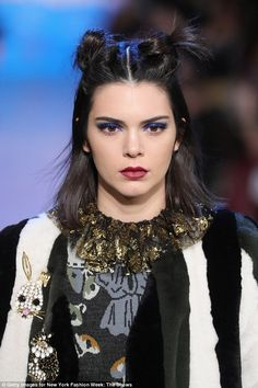 Hard at work: The Keeping Up With The Kardashians star also looked funky for the Anna Sui show