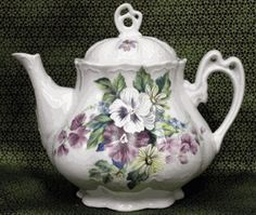 Ashley Bouquet of Pansies Teapot.  This along with tea cup, tray and serving tray would make such a beautiful serving display.  Purple table cloth and purple linens, well, I'm there.