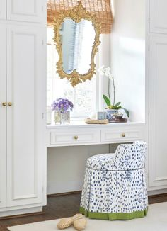 Sarah Bartholomew A lovely spot featuring a vanity chair upholstered in Brunschwig & Fils Les Touches banded in green, matchstick blinds, a blue and white Chinese cachepot with an orchid, and a gold m