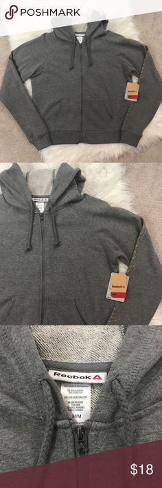 NWT Reebox Zip Up Hoodie Heres a super cute brand new with tags reebok zip up hoodie in a size medium! Great condition! I love the gold spell out on the right sleeve! Too fun! Perfect for the gym or everyday wear! :) Reebok Jackets & Coats