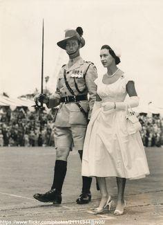 https://flic.kr/p/wmX5cN | Princess Margaret arrives in Dar-es-Salaam | DATE:October 9 1956 D:Princess Margaret walks beside the escorting officer when she inspected the Guard of honour on her arrival in Tanganyika /original photo