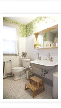 Love almost everything about this bathroom. Sink, tile, base boards, wall paper idea..love!
