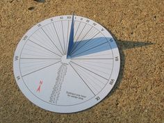 Picture of 15-minute paper-craft sundial http://plus.maths.org/content/analemmatic-sundials-how-build-one-and-why-they-work  http://www.instructables.com/id/Large-driveway-sidewalk-or-garden-sundial/