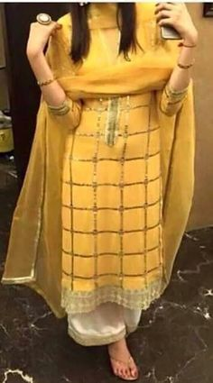 Yellow suit . get it made at @nivetas design studio whatsapp +917696747289 www,facebook.com/punjabisboutique