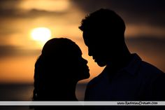 silhouette engagement shoot beach