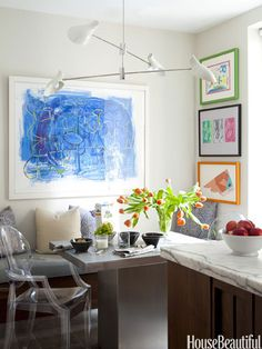 Children's art projects are given the artist treatment with frames in this Park Avenue apartment's kitchen.