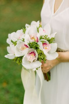 Cymbidium/orchid and green peppercorn bouquet! Tay and Evelyn's Homemade Singapore Wedding at Fort Canning Park