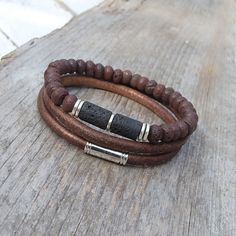 This bracelet consists of two separate layers. The first layer has dark brown and black lava beads. This layer is elastic - it is very easy to wear.