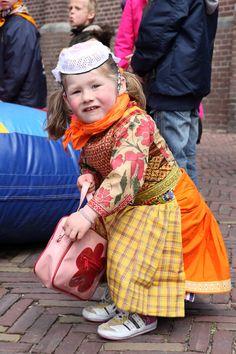 Koninginnedag op Marken 2010 - modern girl dressed in folkloric costume, especially made for 30 april. Photo by Arjan Groot