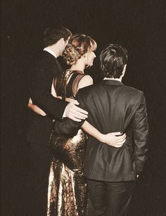 Liam Hemsworth, Jennifer Lawrence and Josh Hutcherson. Again look where Josh's hand is. They totally need to be together.