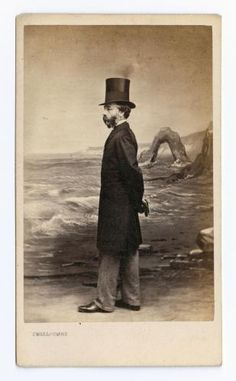 Carte-de-visite depicting gentleman in top hat by studio sea scape, by James Charles Smallcombe, London, 1861 - 1869  #Beards #FacialHair #VictorianSensation
