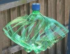 Soda Bottle Wind Spinner.. So cute! would be great in the vege garden to shoo away the birds.
